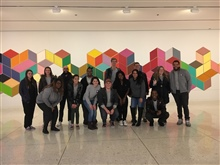 ABLE members gather together for a photo in front of a piece of art in Albany, NY.
