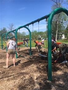 ABLE members help clean a playground in Buffalo, NY.