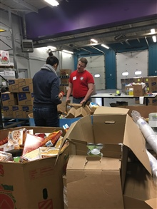 ABLE members organize donations at the Food Bank of WNY.