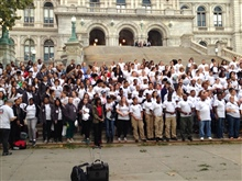 A large group of AmeriCorps members gather together.