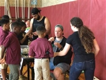 ABLE members assist students in the gymnasium.