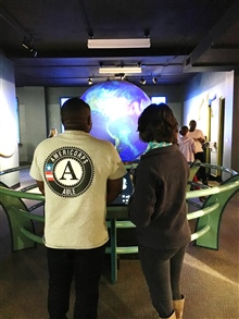 ABLE members view a model of the earth at the Buffalo Museum of Science.